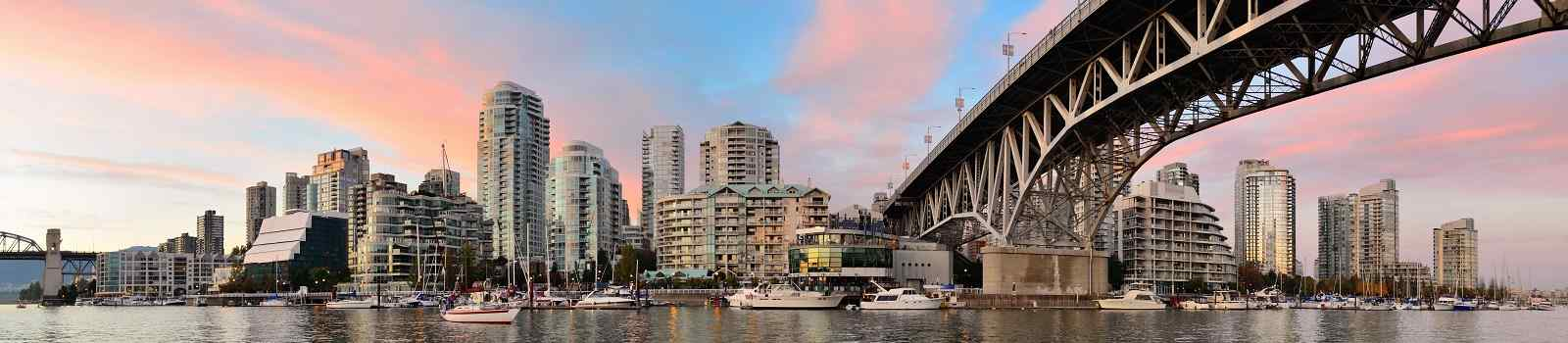 CAD-WEST-TESLA Vancouver False Creek panorama at sunset with bridge and boat 438921508